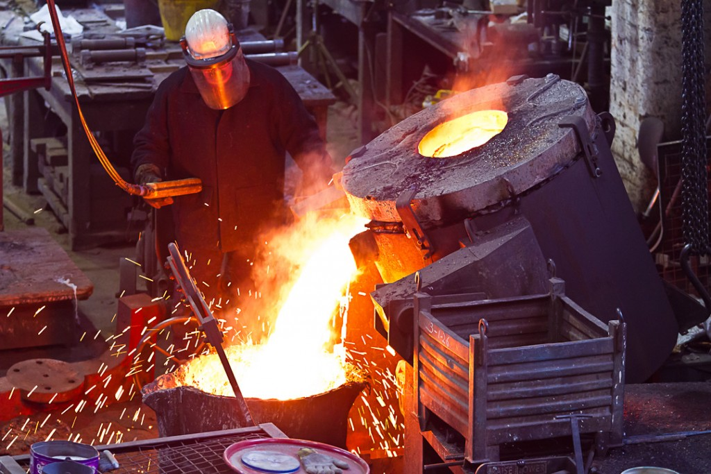 Molten metal pouring into crucible